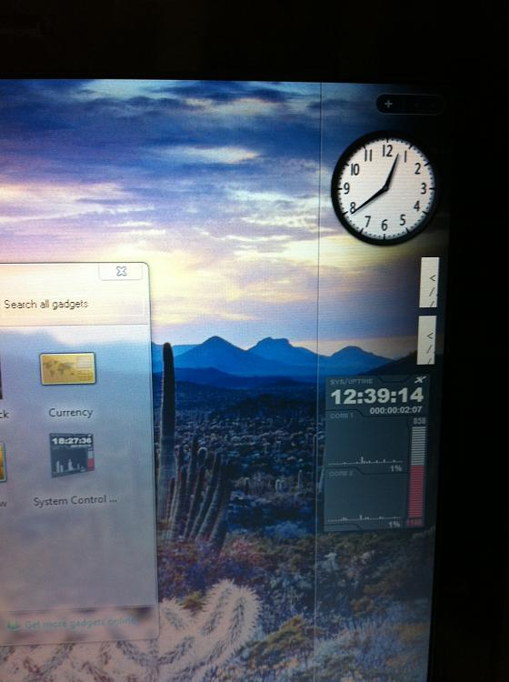 My windows 7 sidebar glich-photo.jpg