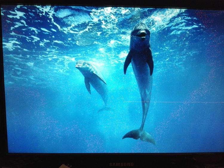New Win7 install, triple monitors, 1 monitor displays lots of grains-1.jpg